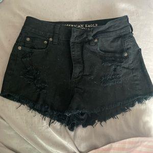 ripped black american eagle shorts